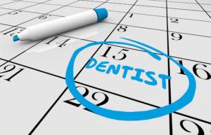 Calendar with circled reminder for dental checkups